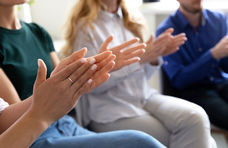 close up of hands clapping in a group session
